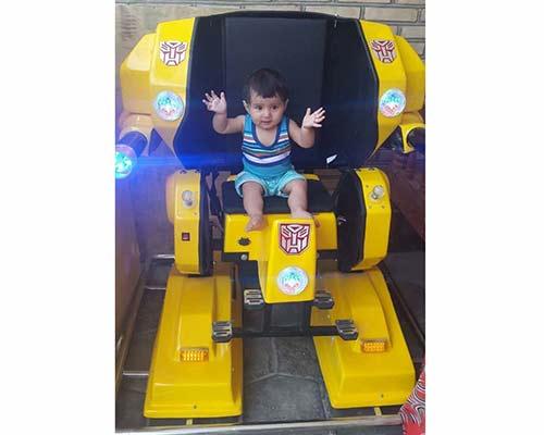 children robot ride in yellow color