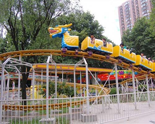 yellow color sliding dragon roller coaster rides